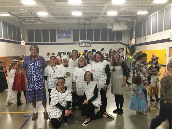 Staff dressed as sheep and Little Bo Peep in Halloween parade.