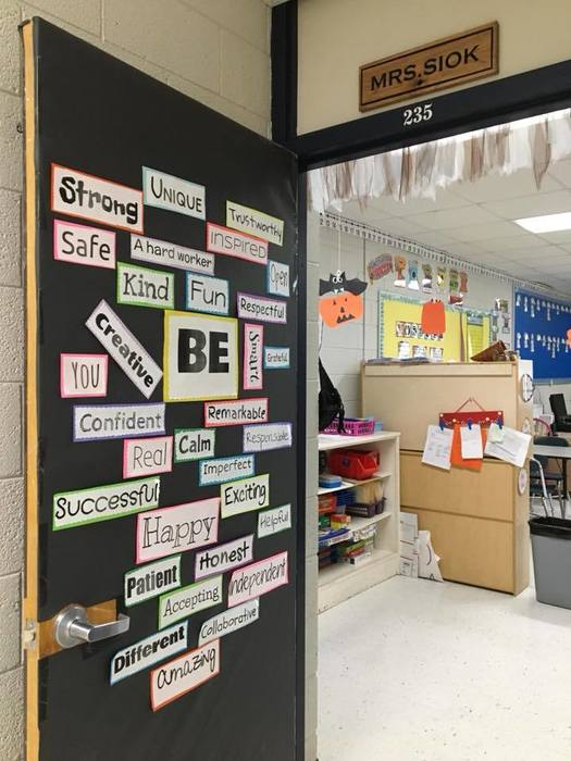 Classroom door covered in words discribing expected student behavior.